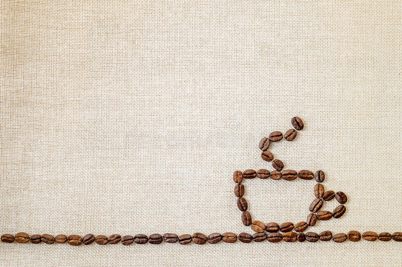 Burlap Sackcloth Canvas and Coffee Beans Photo Background. Copy. Space. Coffee Border royalty free stock photo