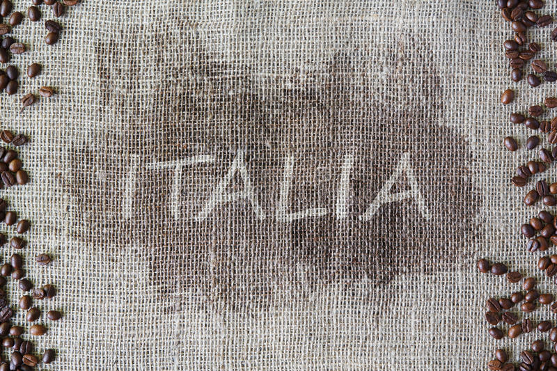 Burlap texture with coffee beans border. Sack cloth background with Italy title, word Italia in the middle. Brown natural sackcloth canvas. Seeds at hessian stock photo
