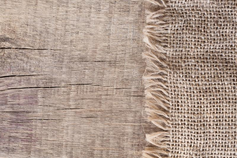 Burlap textureon a wooden background, rustic, christmas . Pattern fabric textile. Texture background.  stock images