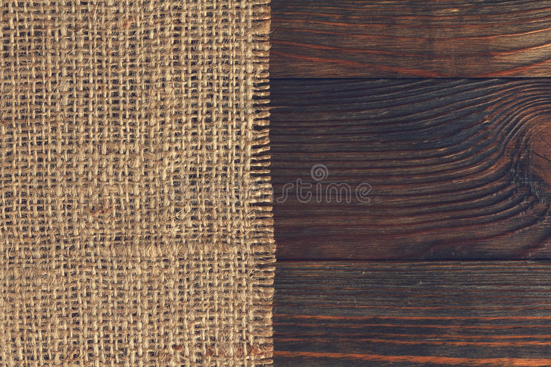 Burlap on wood stock photography