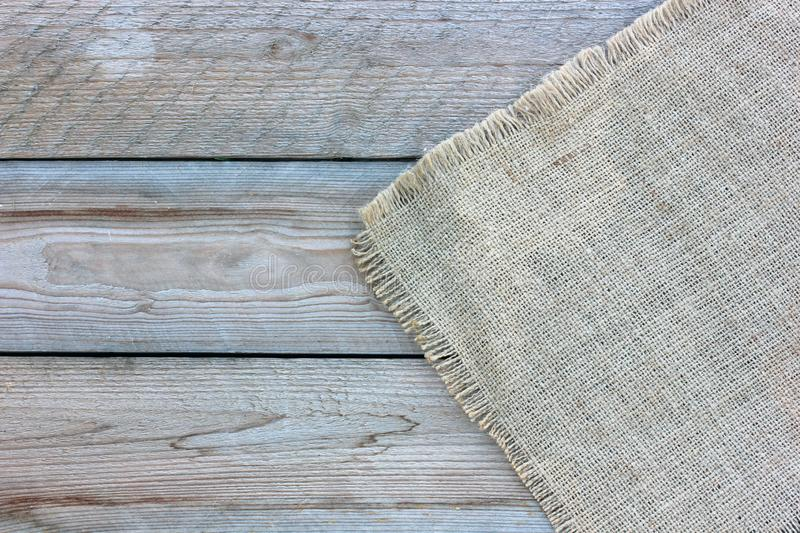 Burlap on the wooden background, top view.  empty space stock photo