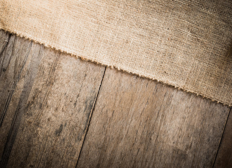 Burlap and wooden texture background royalty free stock photo