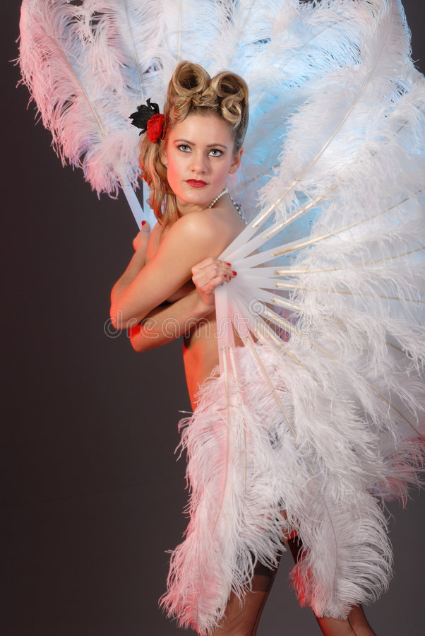 Burlesque artist with ostrich feather fan. Burlesque fan dance artist with ostrich feather fan royalty free stock photos