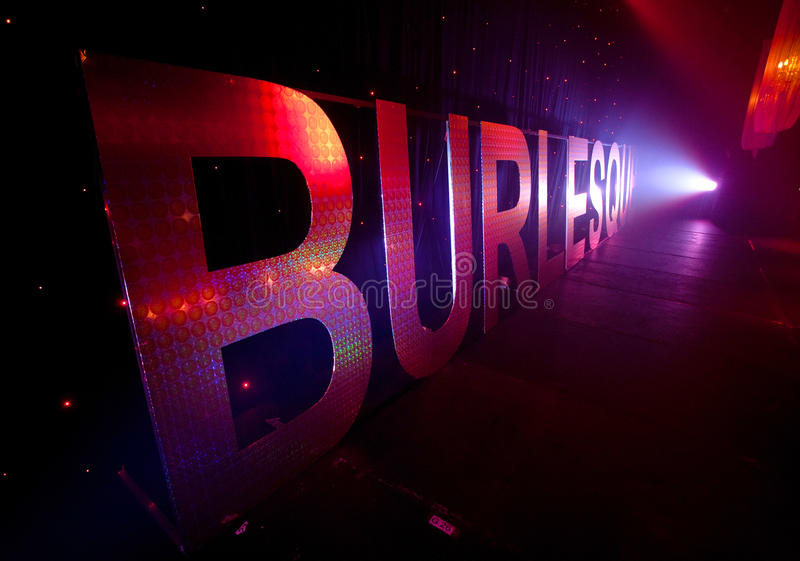 Burlesque Backstage Sign. A perspective view of an embellished cut out sign spelling out the word burlesque with a spotlight shining on it royalty free stock images
