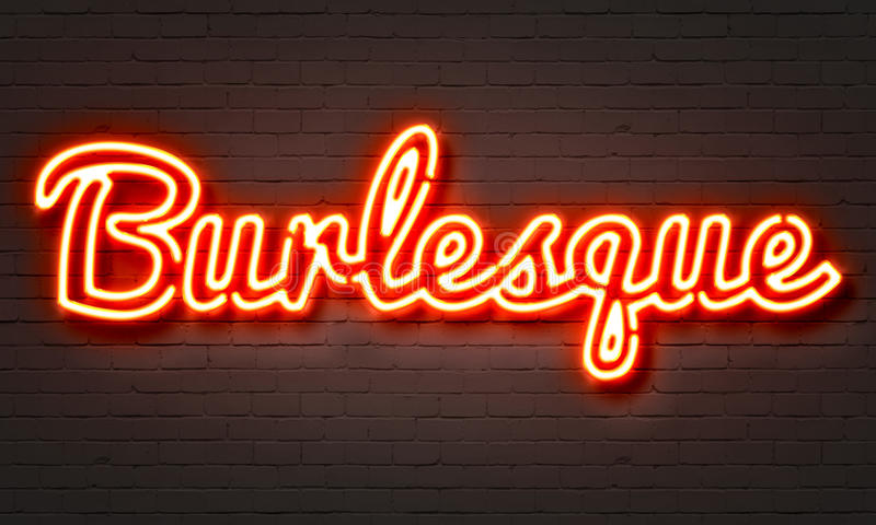 Burlesque neon sign on brick wall background. stock photography