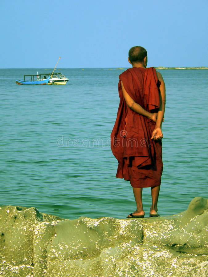 Free Burma. Monk Standing On Rock Stock Image - 2331511