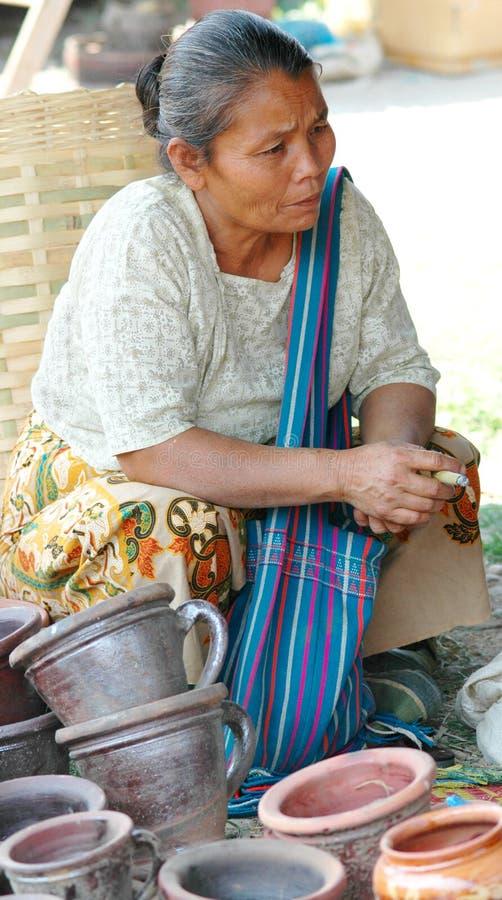 Burma woman selling pottery stock photo