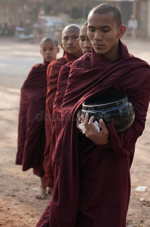 Buddhist Monks collecting alms in Myanmar stock image
