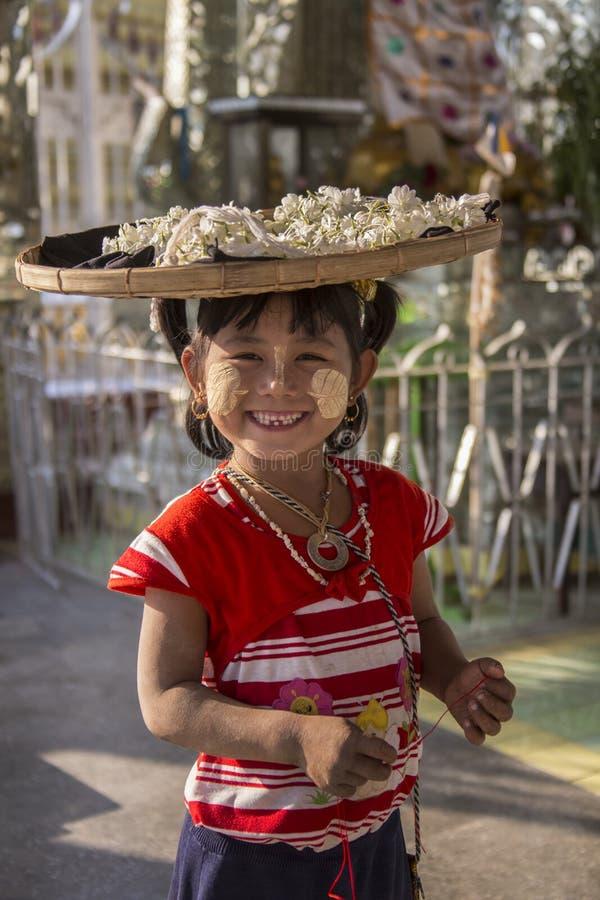 Burmese Child - Mandalay - Myanmar (Burma). A young Burmese girl selling flowers as temple offerings in Mandalay in Myanmar royalty free stock photo