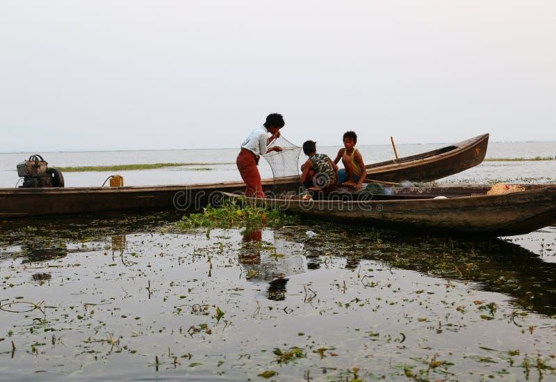 Burmese Children. 10 April 2013: Inle Lake, Myanmar: Burmese children enjoys fishing at Inle Lake, Myanmer royalty free stock image