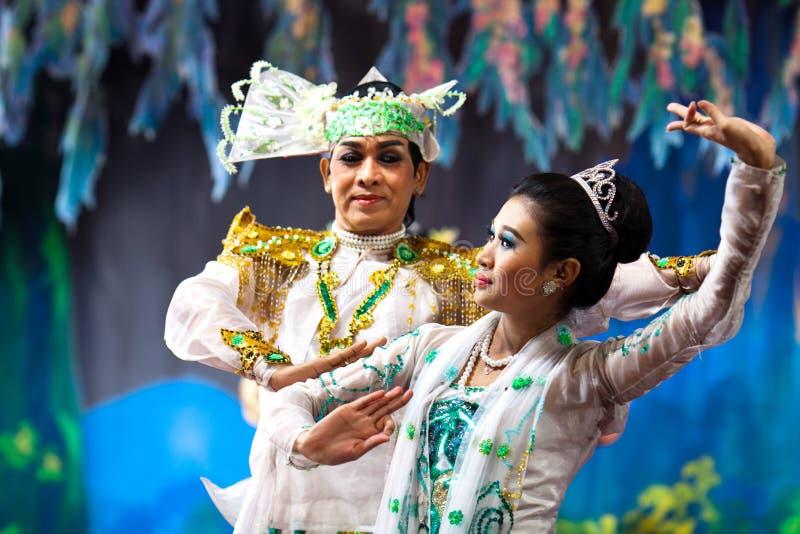 Burmese Dance - Asian Traditional Theatre and Dance. YANGON, MYANMAR - JANUARY 25: Actors performing traditional Burmese dance on evening show in Karaweik Hall royalty free stock image