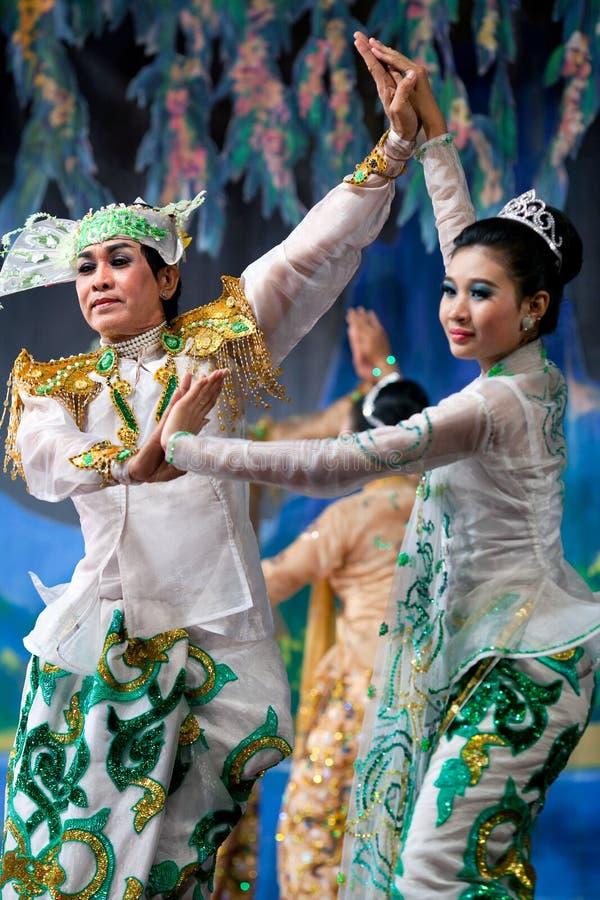 Burmese Dance - Asian Traditional Theatre and Dance. YANGON, MYANMAR - JANUARY 25: Actors performing traditional Burmese dance on evening show in Karaweik Hall stock photography