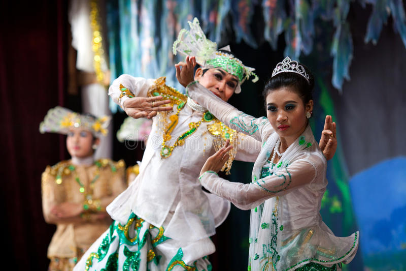 Burmese Dance - Asian Traditional Theatre and Dance. YANGON, MYANMAR - JANUARY 25: Actors performing traditional Burmese dance on evening show in Karaweik Hall royalty free stock photo