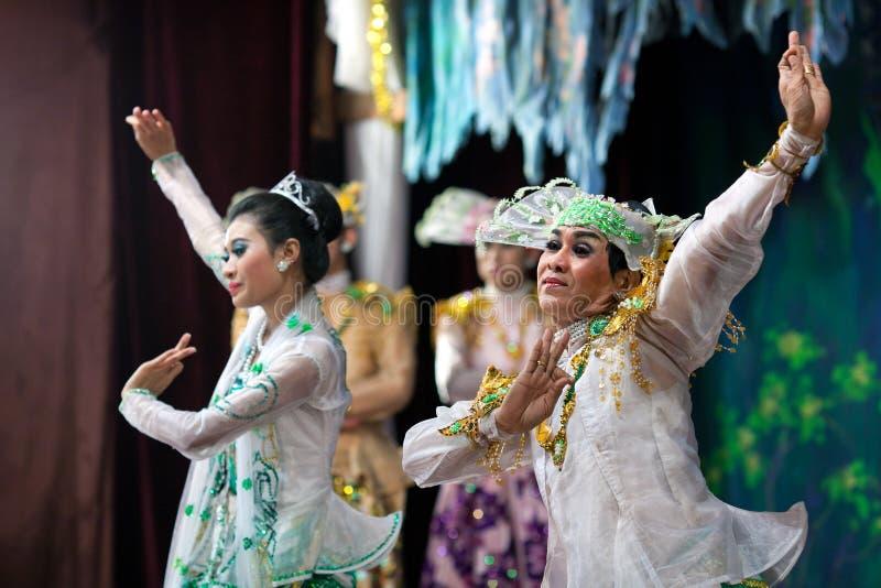 Burmese Dance - Asian Traditional Theatre and Dance. YANGON, MYANMAR - JANUARY 25: Actors performing traditional Burmese dance on evening show in Karaweik Hall stock photos