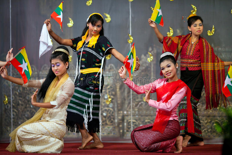Burmese Dance - Asian Traditional Theatre and Dance. YANGON, MYANMAR - JANUARY 25: Actors performing traditional Burmese dance on evening show in Karaweik Hall stock image