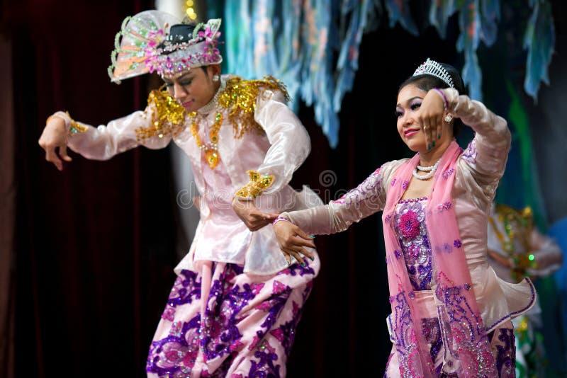 Burmese Dance - Asian Traditional Theatre and Dance. YANGON, MYANMAR - JANUARY 25: Actors performing traditional Burmese dance on evening show in Karaweik Hall stock images