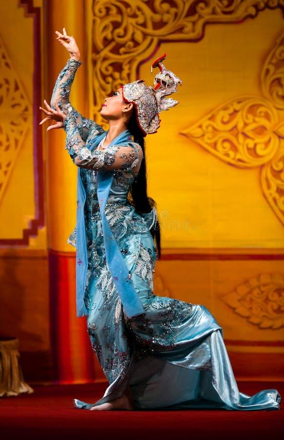 Burmese Dance - Asian Traditional Theatre and Dance. YANGON, MYANMAR - JANUARY 25: Beautiful girl performing traditional Burmese dance in Karaweik Hall on stock photography