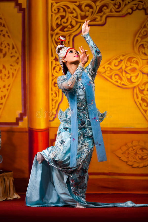 Burmese Dance - Asian Traditional Theatre and Dance. YANGON, MYANMAR - JANUARY 25: Girl performing traditional Burmese dance in Karaweik Hall on January 25, 2011 royalty free stock image