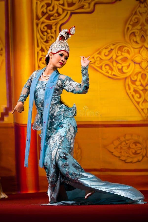 Burmese Dance - Asian Traditional Theatre and Dance. YANGON, MYANMAR - JANUARY 25: Girl performing traditional Burmese dance in Karaweik Hall on January 25, 2011 royalty free stock photo