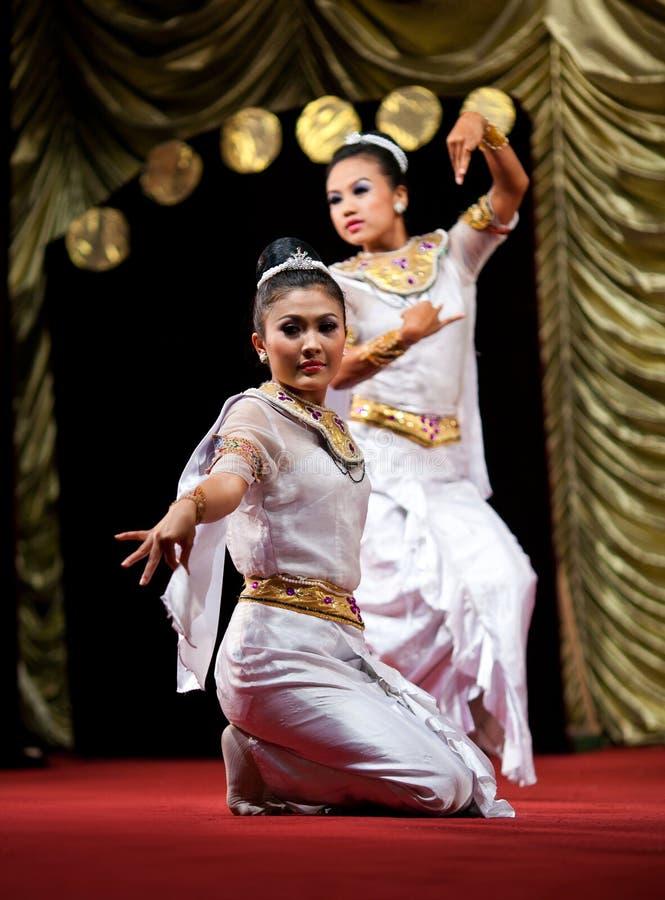 Burmese Dance - Asian Traditional Theatre and Dance. YANGON, MYANMAR - JANUARY 25: Girls performing traditional Burmese dance on evening show in Karaweik Hall on stock photos