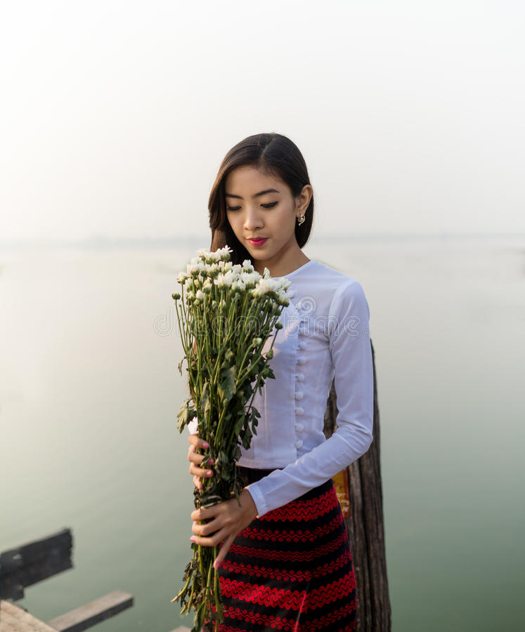 Burmese girl with flowers In the morning stock images