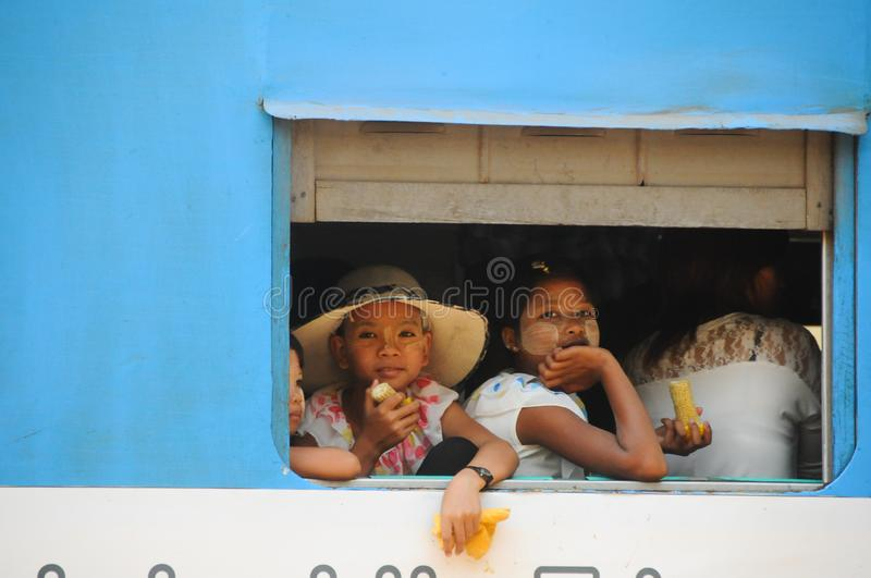 Burmese girls in the train. Portrait of traditional Myanmar little girl royalty free stock photography