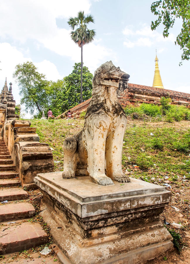 Burmese guardian lion 2. Burmese guardian lion at Inwa ancient city, Myanmar royalty free stock images
