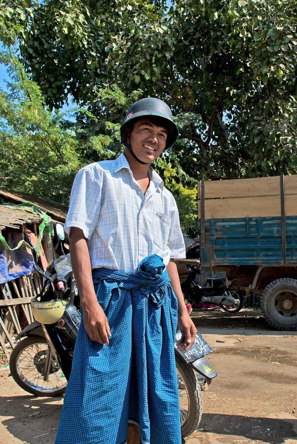 Burmese in the helmet. Burmese young man in a German helmet from World War II stock photos