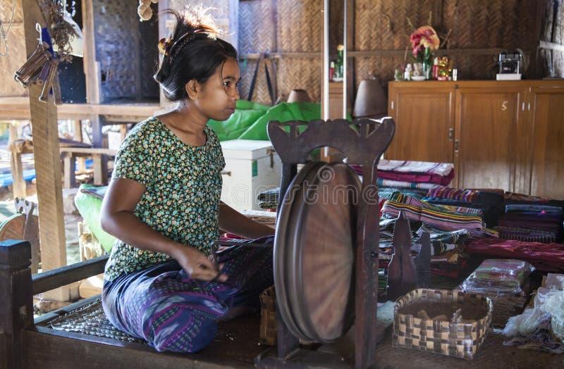 Burmese lady making yarn stock photography