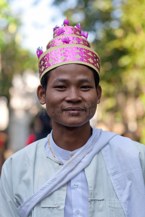 Burmese man. MYITKYINA, MYANMAR - JANUARY 04: An unidentified Burmese young man in national clothes posing for the photo during the Manaw Festival on January 04 royalty free stock images