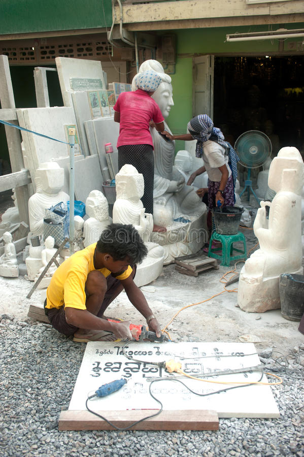 Free Burmese Man Carving A Large Marble Buddha Statue. Royalty Free Stock Images - 46868609