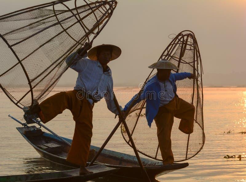 Burmese men catching fish on lake in Inle, Myanmar.  royalty free stock photo
