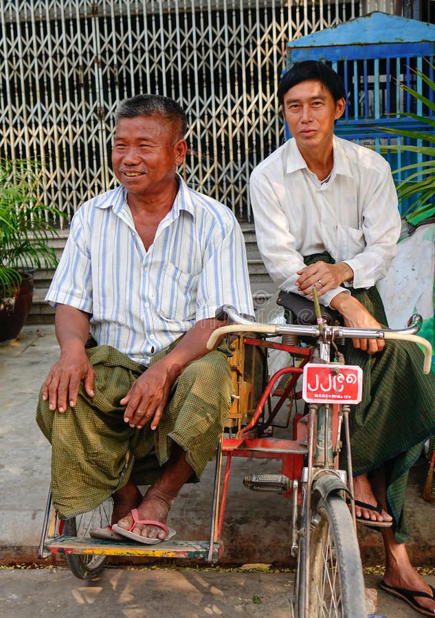 Burmese men sitting on street in Yangon, Myanmar royalty free stock photos