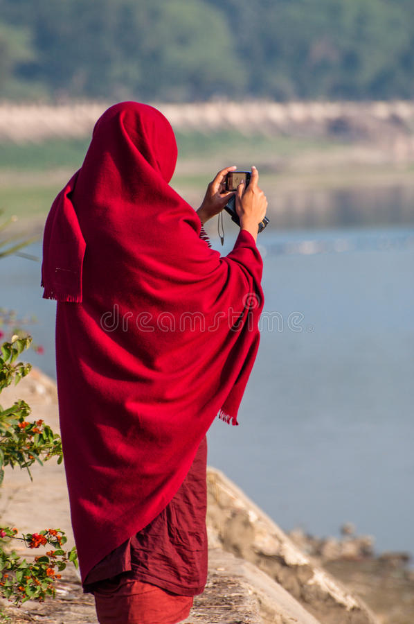 Burmese monk taking a picture stock images