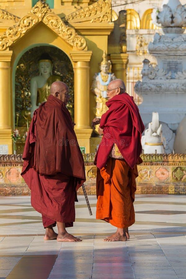 Burmese monks visit the Shwedagon Pagoda. Yangon, Myanmar, Burma stock photo