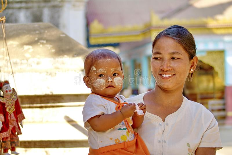 Burmese mother and baby. At a gift shop in the Bagan Archaeological Zone, Bagan, Myanmar royalty free stock photo