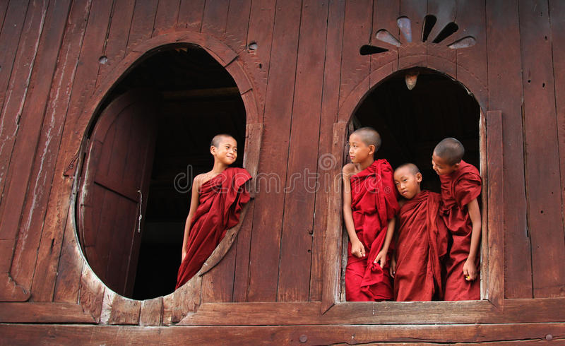 Burmese novice boys in Mandalay. MANDALAY, MYANMAR - MAY 23, 2014 - Burmese novice boys in Mandalay. Myanmar is the most religious Buddhist country in terms of stock photos