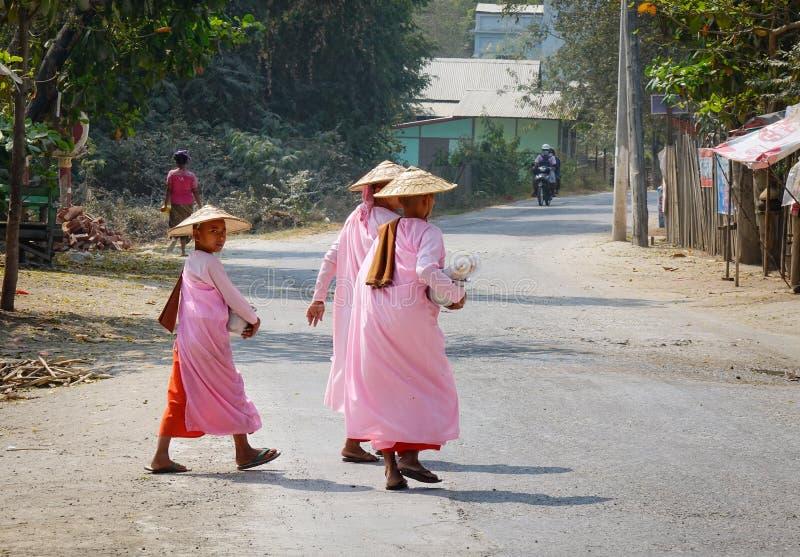 Burmese nuns walking on street at Mingun village in Mandalay, Myanmar.  stock photography