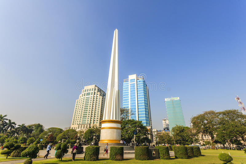 Burmese people visit at Independence Monument in Mahabandoola park in downtown Yangon. Myanmar royalty free stock photography
