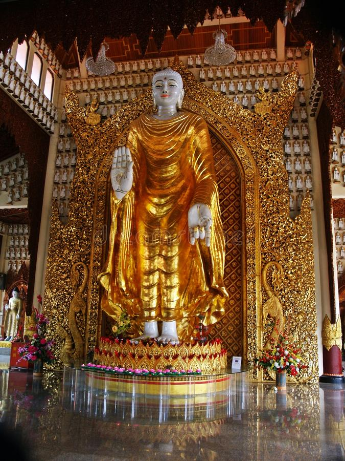 Burmese Standing Buddha. Standing Buddha in Dharmikarama Burmese Temple was the 1st Buddhist temple built in Penang Island, Malaysia royalty free stock photography