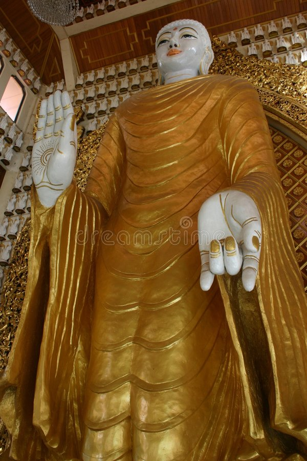 Burmese Standing Buddha. Standing Buddha in Dharmikarama Burmese Temple was found in 1803. It was known as Nandy Molah Burmese Temple royalty free stock image