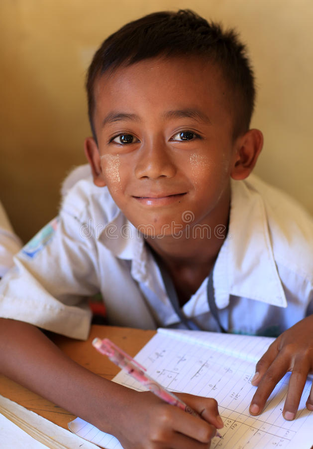 Burmese student at school. Burmese student with thanaka at a school in Yangon, Myanmar royalty free stock images