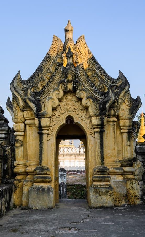 Burmese temple door sculpture. Burmese sculpture detail at Maha Aungmye Bonzan Monastery in Inwa, Myanmar stock photos