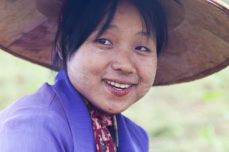 Burmese woman. Portrait of a burmese woman with thanaka powdered face who works in the field stock image