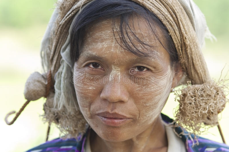 Burmese woman. Portrait of a burmese woman with thanaka powdered face who works in the field stock photo