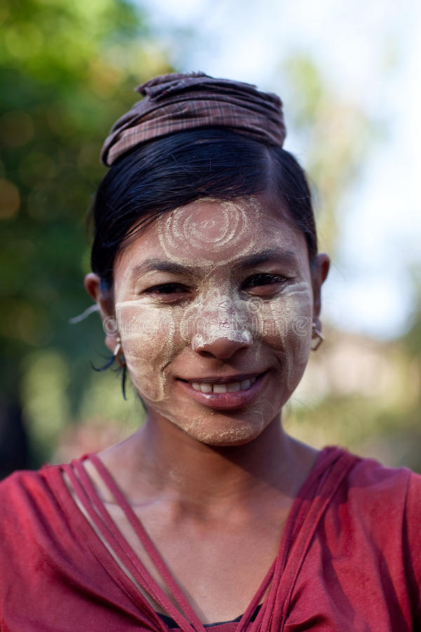 Burmese woman. MYITKYINA, MYANMAR - JANUARY 04: An unidentified Burmese woman with thanaka paste on the face posing for the photo during the Manaw Festival on royalty free stock photos
