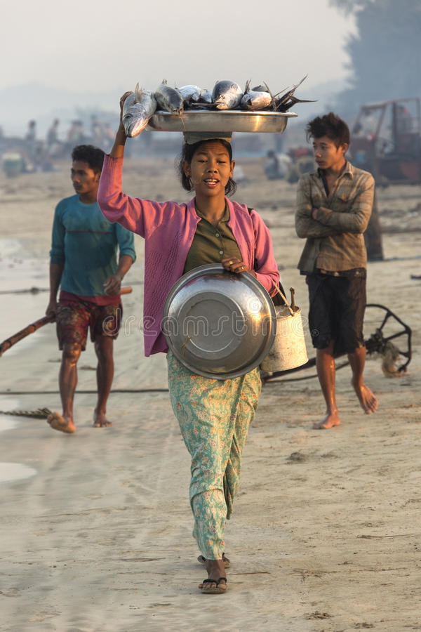 Fishing Village - Ngapali Beach - Myanmar (Burma). Burmese woman with her catch of fish, near the fishing village on Ngapali Beach in Myanmar (Burma royalty free stock images