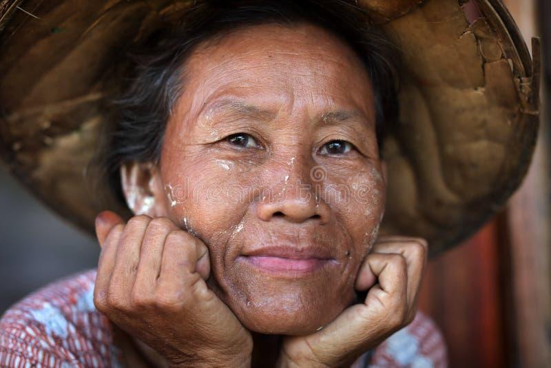 Burmese woman in Mandalay, Myanmar. Burmese woman with traditional hat in Mandalay, Myanmar stock images