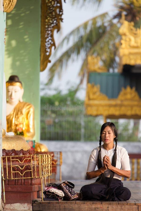 Burmese woman praying Buddha stock image