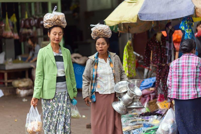 Burmese women carrying bag on head royalty free stock photography